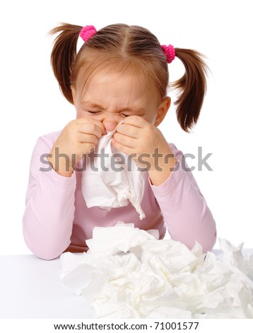 Little girl blows her nose in paper tissue, isolated over white - stock photo