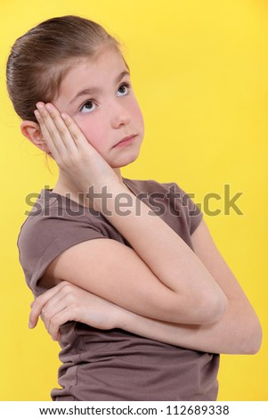 Little girl bored. - stock photo