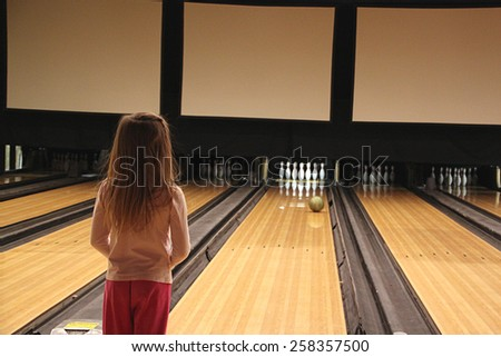 Little Girl Bowling - stock photo