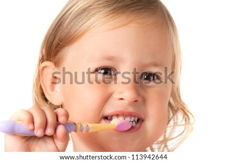 Little girl brushing her teeth, isolated on white background - stock photo