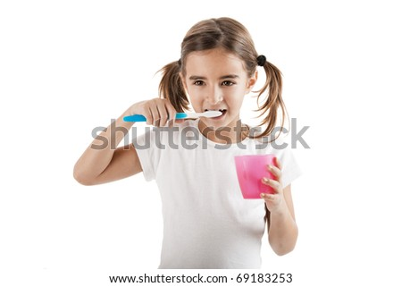 Little girl brushing teeth isolated on white background - stock photo