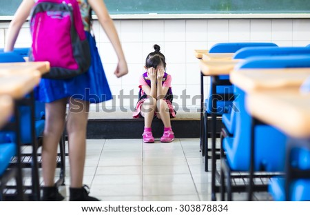 little girl bullying in school classroom - stock photo