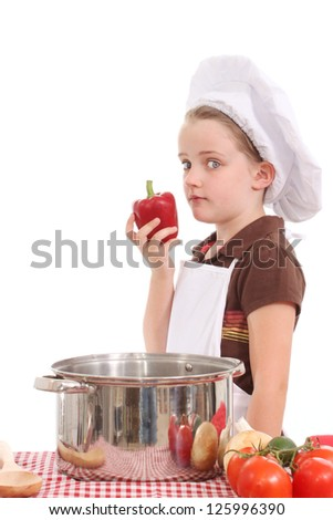 Little girl chef with a red pepper - stock photo
