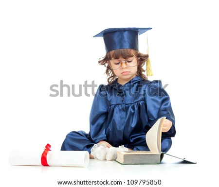 Little girl child in academician clothes  reading book