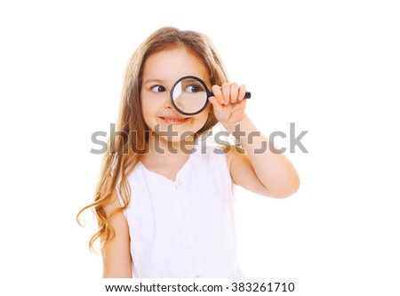 Little girl child looking through a magnifying glass on white background - stock photo