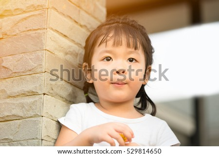 Little girl child waiting her Mother and Father: Healthy happy funny smiling face young adorable lovely female kid with new tooth: Joyful portrait of asian elementary school student