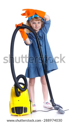 Little girl cleaning floor with vacuum cleaner. Isolated on white background.