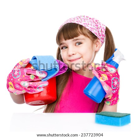 Little girl cleaning isolated on white background - stock photo