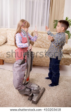 little girl cleaning the room - using vacuum cleane - stock photo