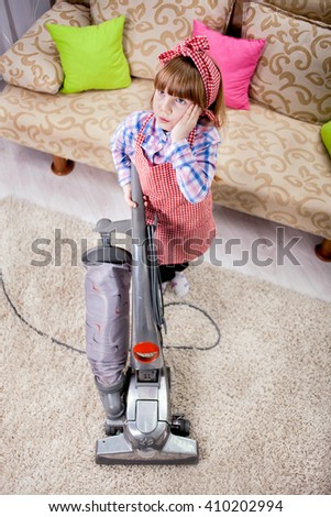 little girl cleaning the room - using vacuum cleaner - stock photo