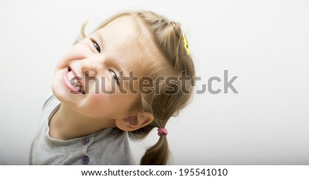 Little girl clenching her teeth - stock photo