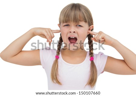 Little girl clogging her ears with her fingers on white background  - stock photo