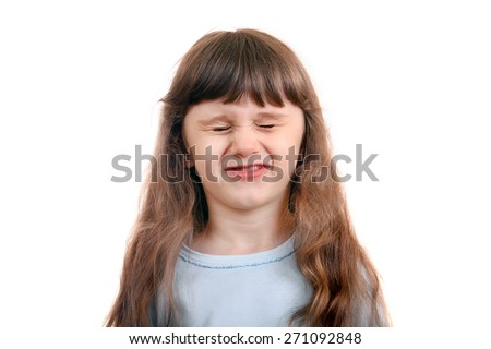 Little Girl close the eyes tight Isolated on the White Background - stock photo
