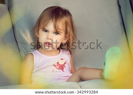 Little girl.  Close up portrait of cute little girl in the park. - stock photo