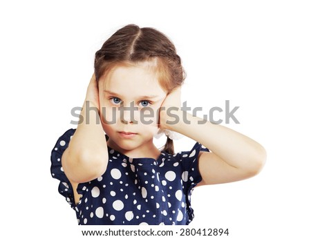 Little girl closed her ears with hands and does not want to listen anyone - stock photo
