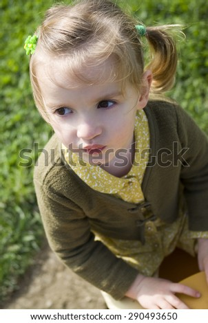 Little girl closeup outdoors - stock photo