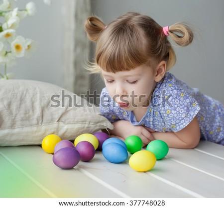 little girl coloring easter eggs - stock photo