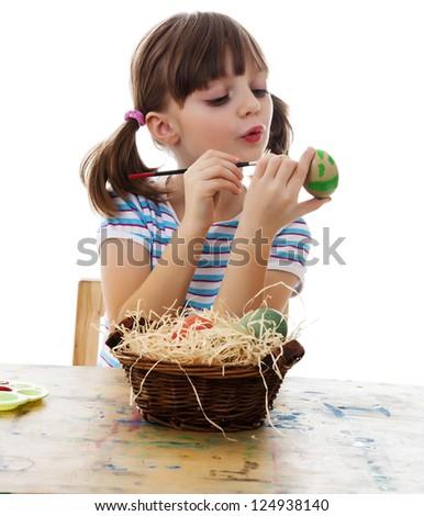 little girl coloring easter eggs white background - stock photo