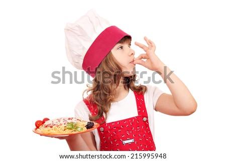 little girl cook enjoying a delicious spaghetti  - stock photo