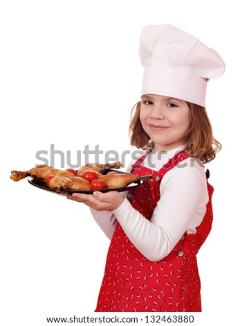 little girl cook hold dish with chicken drumsticks - stock photo