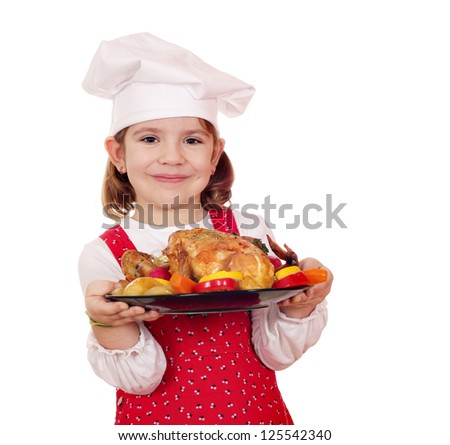 little girl cook holding roasted chicken - stock photo