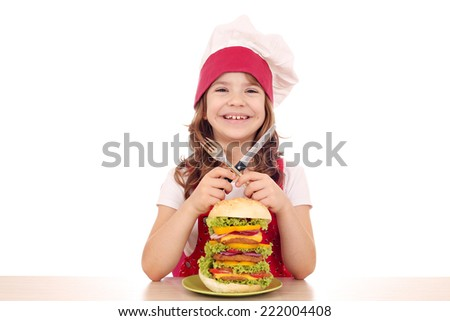 little girl cook with big hamburger on table - stock photo
