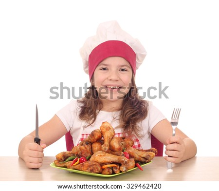 little girl cook with chicken drumstick on plate ready for lunch - stock photo
