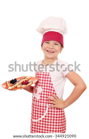 little girl cook with delicious crepes - stock photo