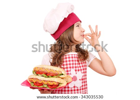 little girl cook with hot dog and ok hand sign