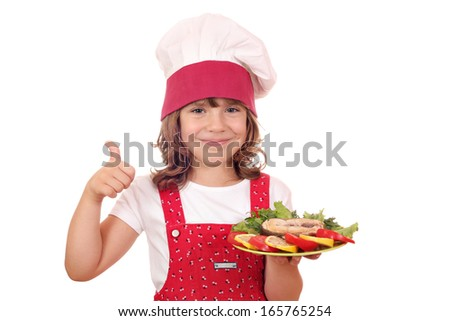 little girl cook with salmon and thumb up - stock photo
