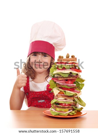 little girl cook with tall sandwich and thumb up