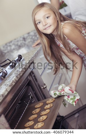 Little girl cooking - stock photo