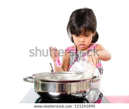 Little girl cooking on white background.