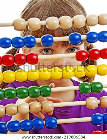 little girl counting with abacus - stock photo