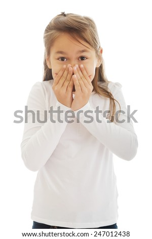 Little girl covered her mouth with his hands - stock photo