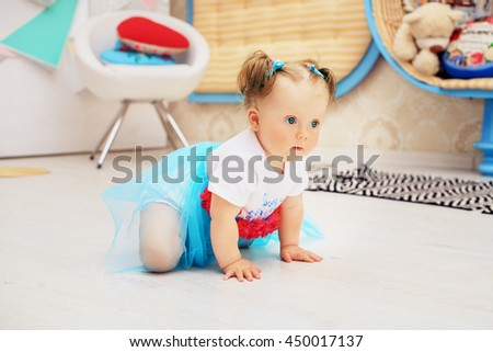 little girl crawling on the floor in the room