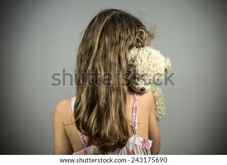 Little girl crying in the corner. Domestic violence concept. - stock photo