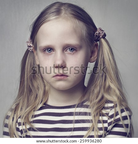 Little girl crying with tears - stock photo