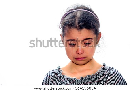 Little girl crying with tears rolling down her cheeks on the white background - stock photo