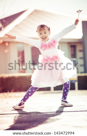Little girl dancing in a fairy outfit - stock photo