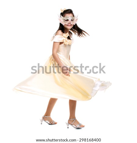 little girl dancing in the carnival mask and festive dress