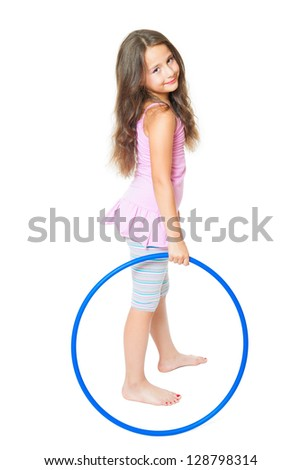 little girl doing fitness exercise with a blue hoop - stock photo