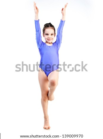 little girl doing gymnastics isolated on white