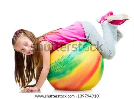 Little girl doing gymnastics with ball over white background - stock photo