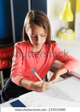 little girl doing home work for school - stock photo