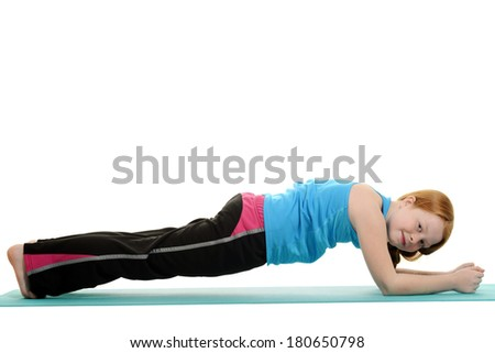 little girl doing plank exercise - stock photo