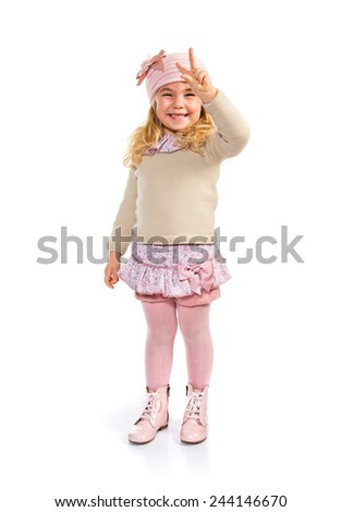 Little girl doing victory gesture
