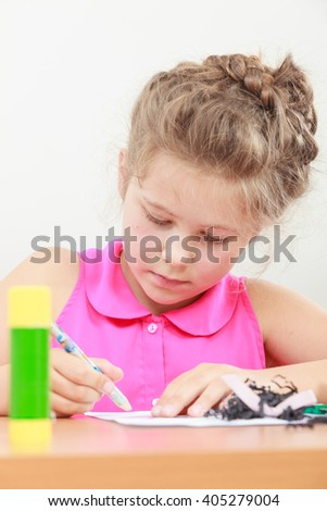 Little girl draw in the classroom. Being creative in elementary age