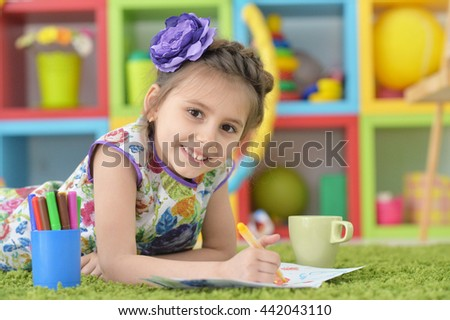 Little girl drawing at  class - stock photo