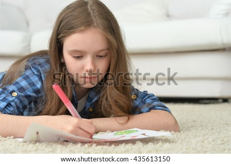 Little girl drawing at home - stock photo